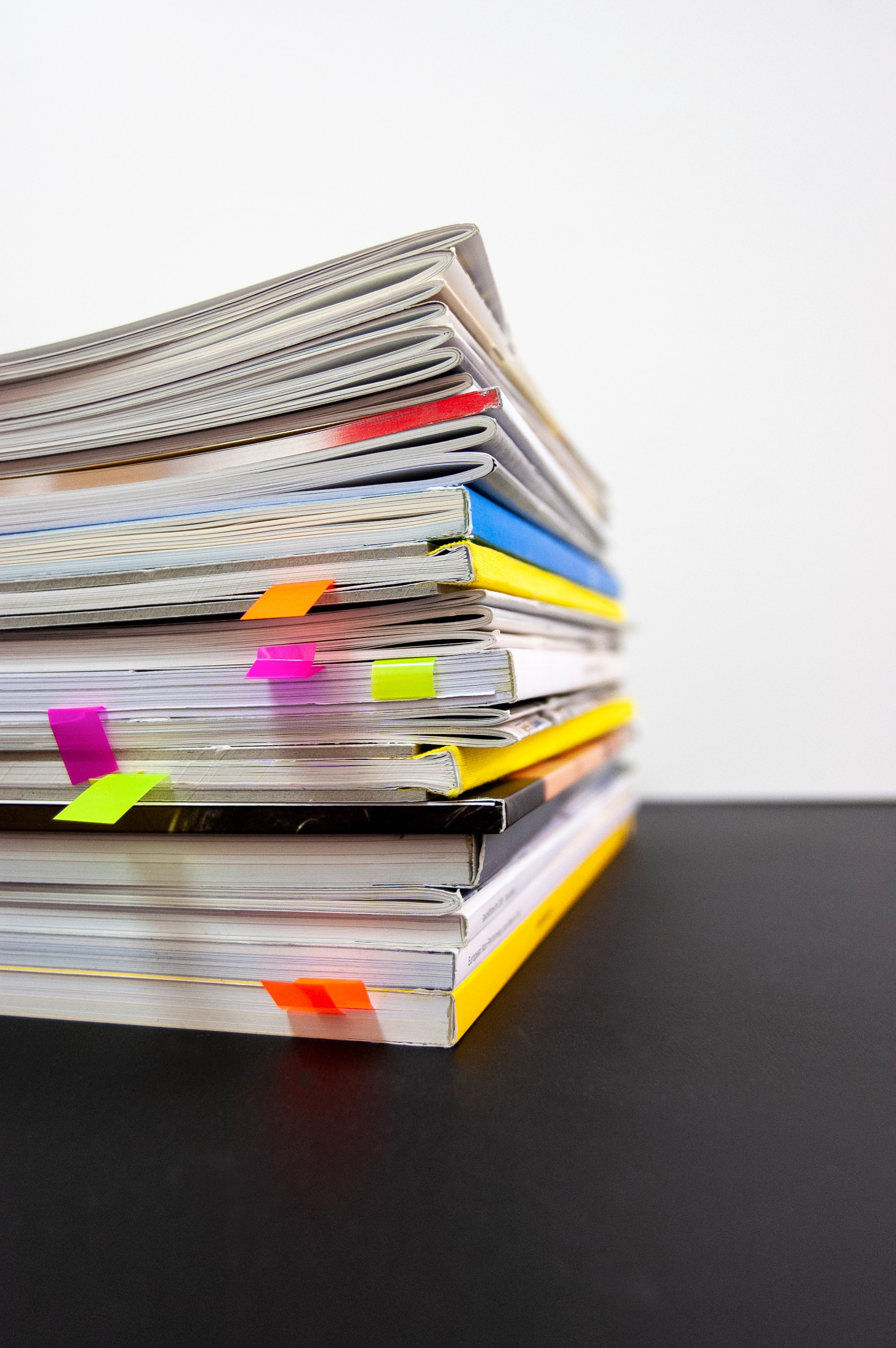 Stack of papers with colourful tabs at end of pages